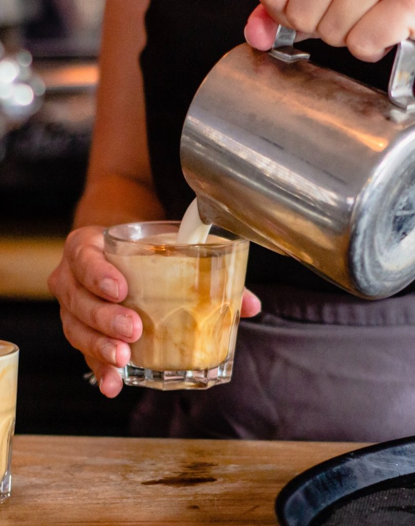 Barista pouring a drink