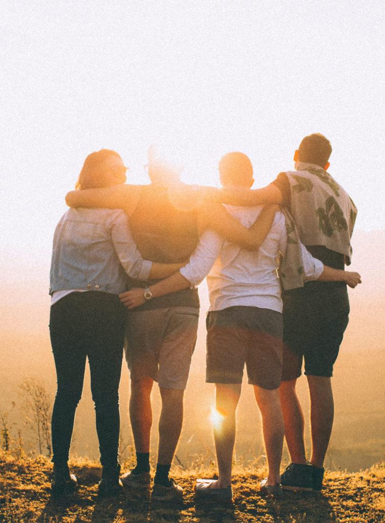 Group Hugging at Sunrise
