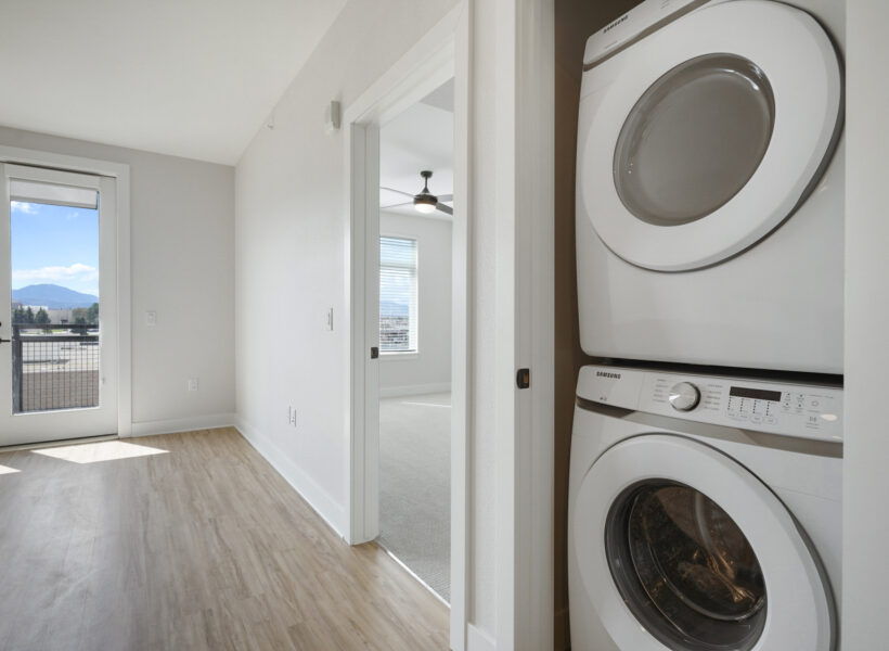 Washer dryer and image of doorway with view of mountains