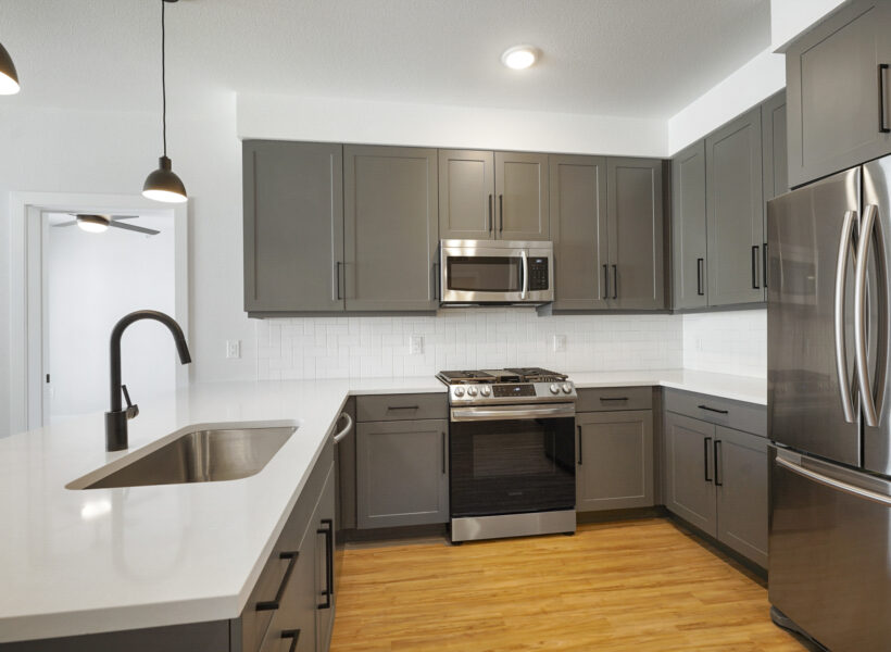 kitchen shot with dark gray cabinets and white walls